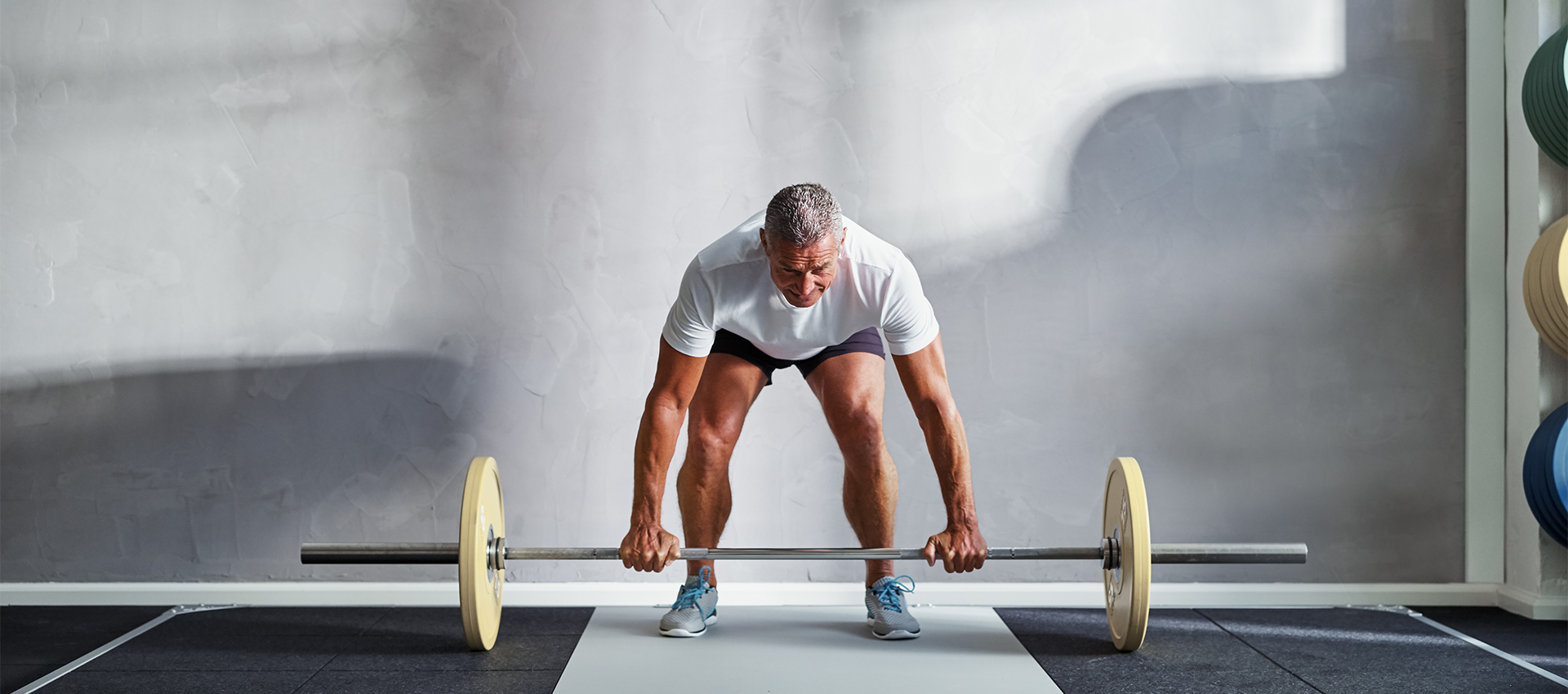 personal trainer lifting weights Endless Life Force